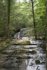 Morganton cabin photo - Waterfall on Stanley Creek Road, off of Aska. Daughter Louise climbing.