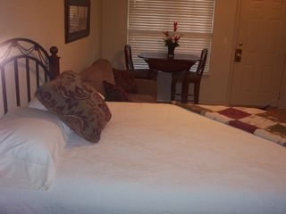 Branson condo photo - Bed, couch & table in lockout 1B