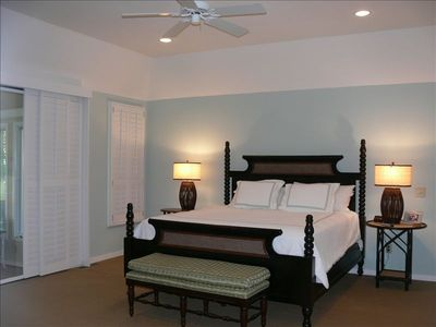 King Bed in Master Bedroom. Master has His and Her walk in custom closets
