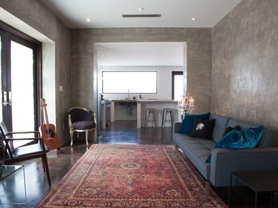 Private 2,000 sq ft. minimalist-industrial private compound with rocker accents.