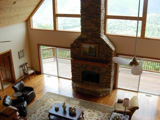 Sapphire house photo - View of living room with massive fireplace and deck from 2nd level.