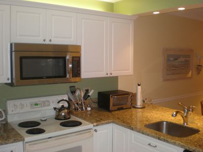 Our new kichen May 2012 with granite counters. new cabinets, and appliances