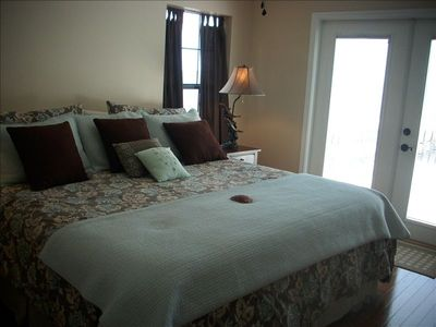 Master bedroom,king size bed, hardwood floors, french doors to upper deck.