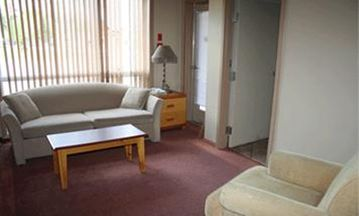 Waterton Lakes National Park condo rental - Living Room w/ Private Bathroom and entrance