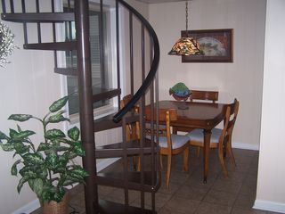 Claytor Lake house photo - Spiral stairway to lower level. Game table or additional eating area.