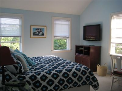 Master Bedroom with king-sized bed, flat screen tv