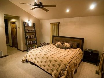 Master Bedroom leading to his/her walk-in closets and master bath.