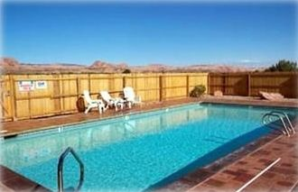 Cool off in the pool or melt away in the hot tub at our Moab vacation rental