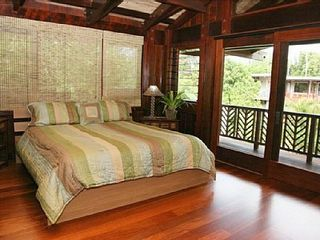 Haena house photo - Master bedroom with glass sliding doors to outside lanai