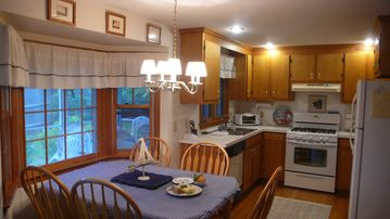 Kitchen with dishwasher, microwave. Table insert and chairs for 8