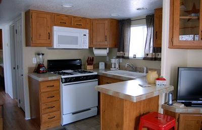 Fully equiped kitchen with blender, crockpot, coffee pot and much more.