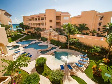 Puerto Aventuras condo rental - Actual View from our balcony of pool and ocean
