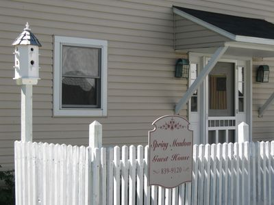 bautiful front of the house with the picket fence