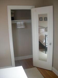 bedroom closet with extra blankets, iron and ironing board