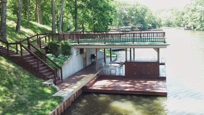 Dock with sun/swim deck, kitchen, 1/2 bath, cable tv & bar area.