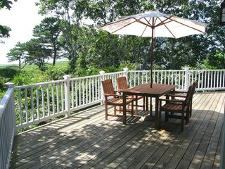 Wellfleet house photo - Two deck tables with umbrellas and view make outside dining easy and comfortable