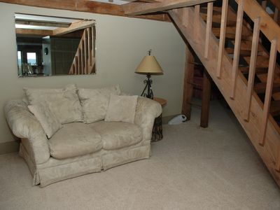 Cozy reading area at the loft stairway and entry to pvt guest and master.