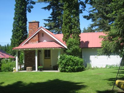 Columbia Falls farmhouse rental - Front of the house (hidden from road by thick bushes).