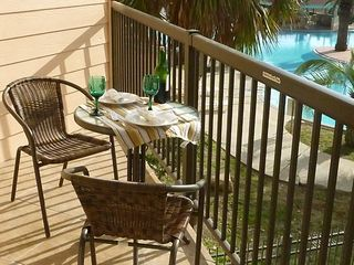 Galveston condo photo - A day time view of the resort pool from your balcony