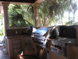 Marathon villa photo - Outdoor grill room with DCS gas grill,sink, and power burner for fish frys.
