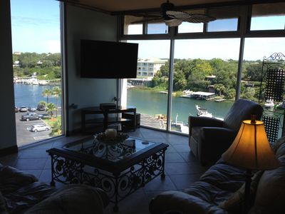Overlooking the Destin Harbor with beautiful floor to ceiling water views. Wow!