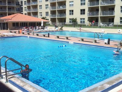 New Smyrna Beach condo rental - Plenty of Pool Water to cool off or excercise. Clubhouse in background.