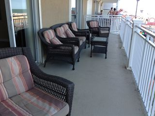 Oceans Mist Ocean City condo photo - Very large deck with comfortable seating overlooking the ocean and boardwalk.