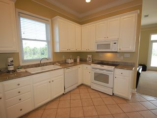 Fort Morgan property rental photo - The large kitchen is equipped with all your standard appliances.