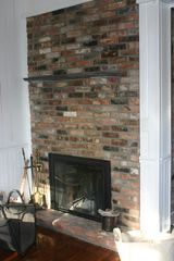Chatham farmhouse photo - Double-sided wood burning fireplace in chef's kitchen/family room