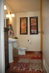 One of two bathrooms, both this style