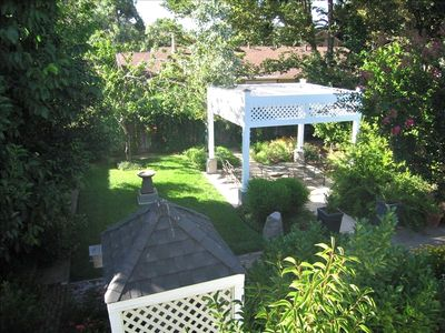 View of the backyard from the deck with it's many places to relax or entertain