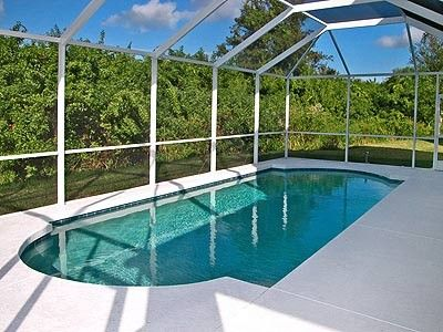 Private fully screened pool with dining area