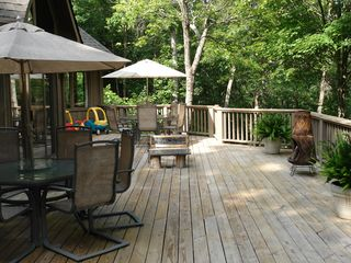 Big Canoe house photo - Main floor deck view from outdoor living room with stone fireplace off kitchen.
