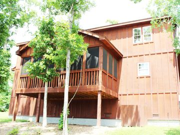 The lodge has a fully screened in back deck that seats 8.