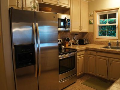 Brand new stainless steel appliances.