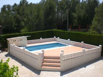 Sunbathe by your own private swimming pool