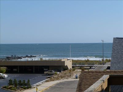 Enjoy this view of the ocean and boardwalk all week from both levels of unit