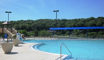 Brand New Outdoor Pool with slides and basketball located at Owner's Club