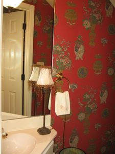 Elegant Little Powder Room with Oriental Wallpaper