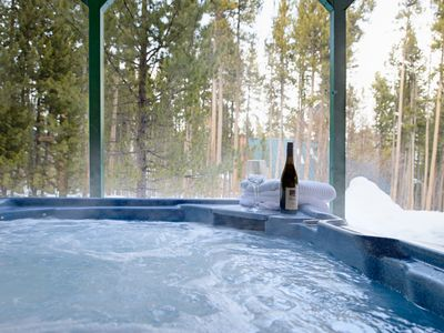 Private with a view to the surrounding pines ... your seat in the hot tub awaits