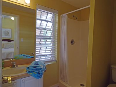 Bathroom with Stand Up Shower, Vanity, Toilet, Window and Mirror.