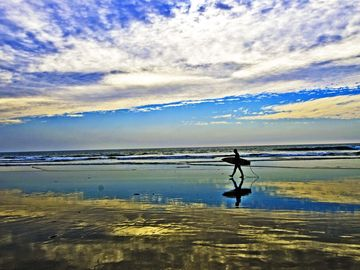 Surfer in Oceanside on a November day in 2012