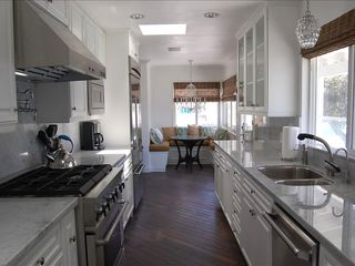 Manhattan Beach house photo - Sunny kitchen with marble counters, nook & professional grade appliances