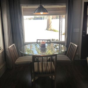 Dining/Game Table in Living room. Great views of lake and yard