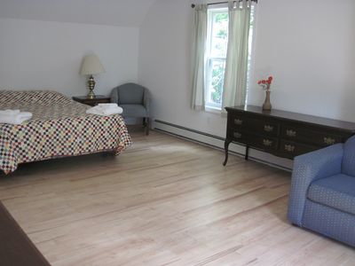 upstairs bedroom with queen bed and sleeper sofa