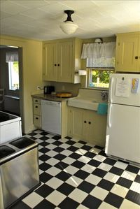 Fully appointed 1920's kitchen includes a dishwasher.