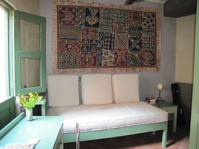 Guanajuato townhome rental - Study-sofa/bed with African batik, ostrich egg light. reading light, ceiling fan