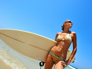 Spend a day surfing or take a paddle board lesson.