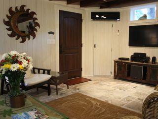 Savannah cottage photo - Living area boasts Surround Sound stereo with iPod dock. Flat screen LED TV.