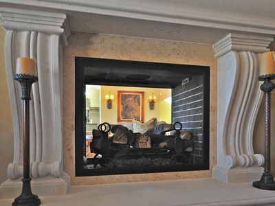 Two way fireplace from great room to seating area